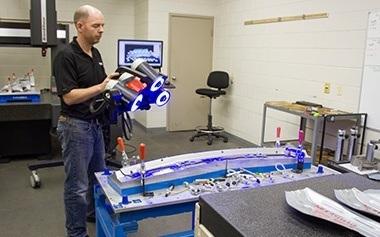 Man examining 3D scan